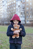 Portrait of a homeless boy with bear Royalty Free Stock Images