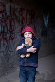Portrait of a homeless boy with bear Royalty Free Stock Photography