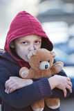 Portrait of a homeless boy with bear Stock Photos