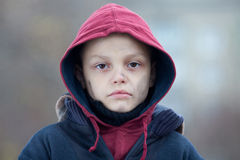 Portrait of a homeless boy Royalty Free Stock Image