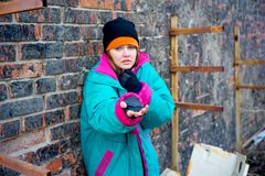 Homeless woman. A portrait of a homeless hungry woman stock photos