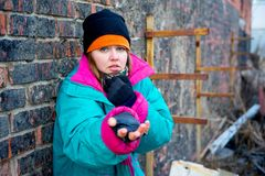 Homeless woman. A portrait of a homeless hungry woman Stock Images