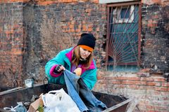 Homeless woman. A portrait of a homeless hungry woman Royalty Free Stock Photography