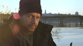 Portrait of homeless man looking with despair stock footage