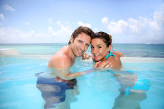 Portrait of honeymooners in swimming-pool Stock Photo