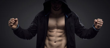 Portrait of a hooded muscular athlete Stock Photo