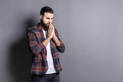 Portrait of hopeful bearded hipster praying Royalty Free Stock Photography