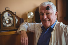 Portrait of horologist wearing magnifying glass Royalty Free Stock Images