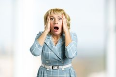 Portrait of horrified mature women. royalty free stock photo