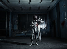 Portrait of the horror zombie woman. Halloween. Portrait of the horror zombie woman in the scary basement. Halloween Royalty Free Stock Photo