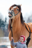 Portrait of of horse and child closeup. Smiling horse and child Stock Photos