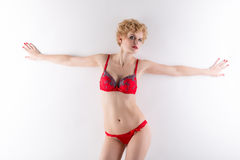 Portrait of hot blonde posing in red lingerie Stock Image