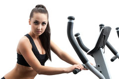 Portrait of hot girl exercising on ski simulator Stock Images