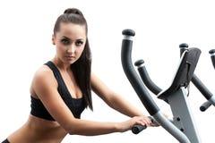 Portrait of hot girl exercising on ski simulator Stock Images