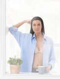 Portrait of hot woman at window Royalty Free Stock Photos