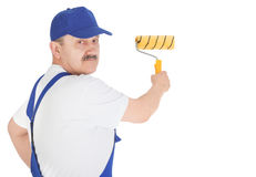 Portrait house painter is painting invisible wall. Isolated on white background Royalty Free Stock Photo