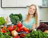 Portrait of  housewife with  cabbage and  vegetables Royalty Free Stock Image