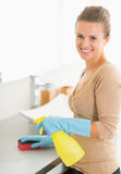 Portrait of housewife cleaning desk in bathroom Royalty Free Stock Images