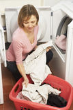 Portrait Of Housewife Doing Laundry. At Home royalty free stock photos