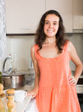 Portrait of housewife at  kitchen Stock Photos