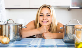 Portrait of  housewife posing at  kitchen Royalty Free Stock Images