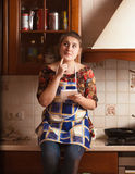 Portrait of housewife remembering recipe of dish Royalty Free Stock Photos
