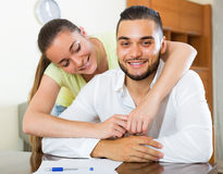 Portrait of hugging couple at home Stock Photo