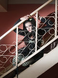 Portrait of a human doll on stairs Royalty Free Stock Photography
