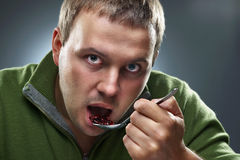 Portrait of hungry man eating beans Royalty Free Stock Image