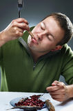 Portrait of hungry man eating fish Stock Photo