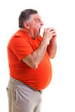 Portrait of a hungry overweight man Stock Photography