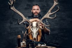 Portrait of hunter man. Holds a deer`s skull Royalty Free Stock Photo