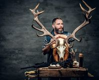 Portrait of hunter man. Holds a deer`s skull Stock Photography
