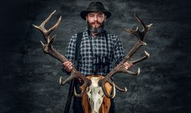 Portrait of hunter man. Holds a deer`s skull Royalty Free Stock Images