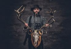 Portrait of hunter man. Holds a deer`s skull Royalty Free Stock Image