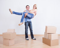 Portrait Of Husband Holding Wife In New Home Stock Photography