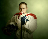 The portrait Ice hockey player on dramatick background Royalty Free Stock Images