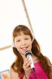Portrait if young girl with microphone royalty free stock photos