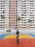 A beautiful asian woman with the vintage style pastel colors building in Hong Kong stock photo