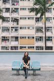 A beautiful asian woman with the vintage style pastel colors building in Hong Kong stock images