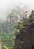 Portrait image of young women with umbrella, Huangshan royalty free stock image