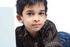 Portrait of Indian Boy. With laptop Royalty Free Stock Images