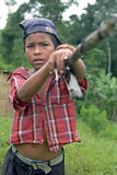 Portrait Indian boy with bamboo fishing rod. Nicaragua, region Bosawas, village Awahwas a Mayangna [literally, sons of the sun] Indian child lugging a long stock photo