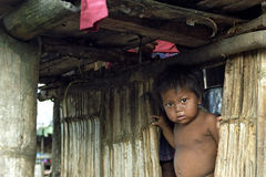Portrait of Indian boy in poor hut of bamboo Stock Image