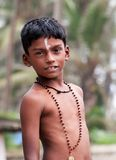 Portrait of Indian boy on the street in fishing village Stock Photo
