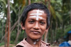 Portrait of Indian boy on the street in fishing village Royalty Free Stock Images