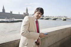 Portrait of an Indian businessman text messaging Stock Photos