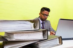 Portrait of Indian Businessman working on his laptop computer at his desk Royalty Free Stock Images