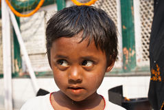 Portrait of Indian child. Portrait of a poor dirty boy child of India, New Delhi, 2011 Royalty Free Stock Images
