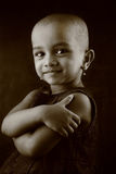 Portrait of an Indian girl child. Monochrome portrait of an Indian girl child with shaved head Stock Image